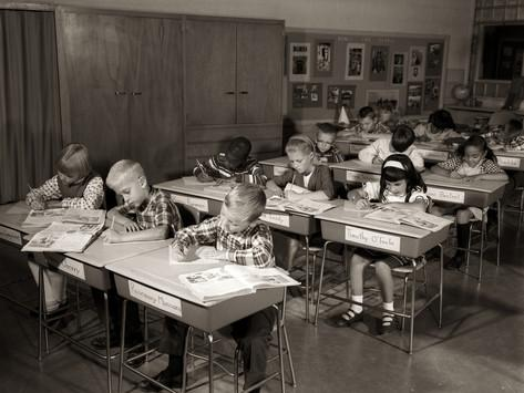 h-armstrong-roberts-1960s-elementary-classroom-children-at-desks-writing-studying